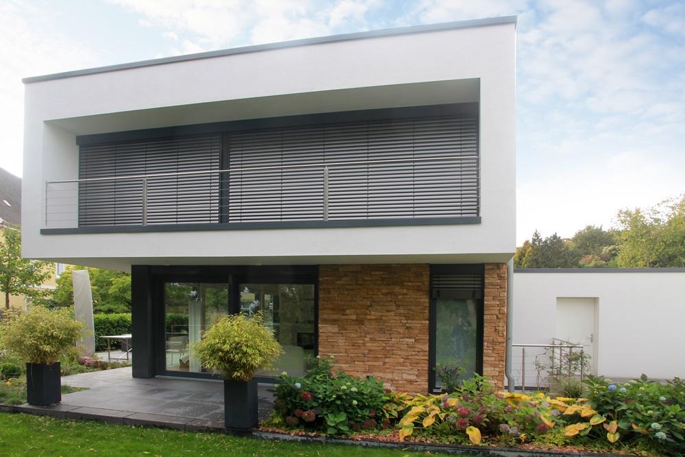 Neubau eines wohnhauses mit carport und geräteraum holtmeyer
